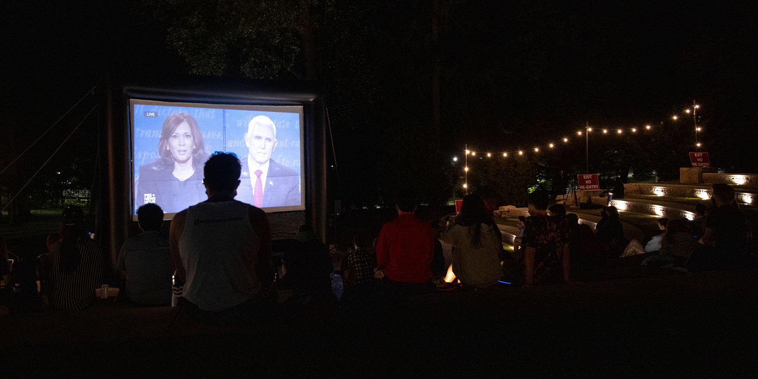 People watch vice presidential debate in outdoor amphitheater