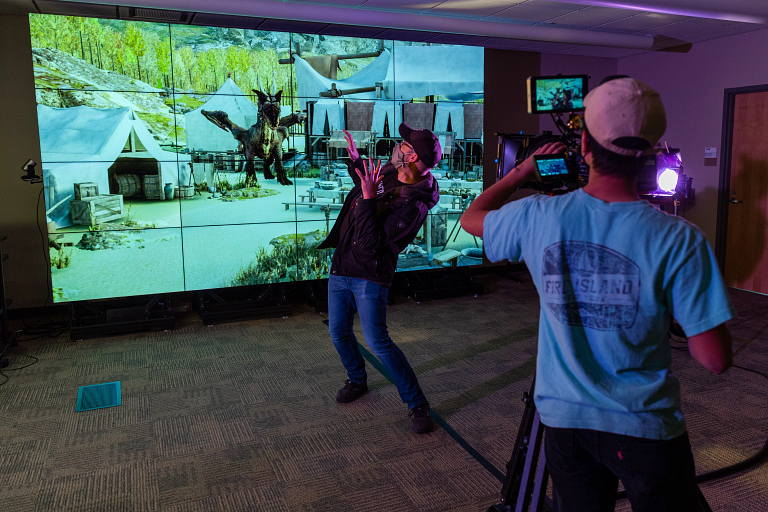 Zebulun Wood reacts to the presence of a virtual dragon on screen during filming of a commercial