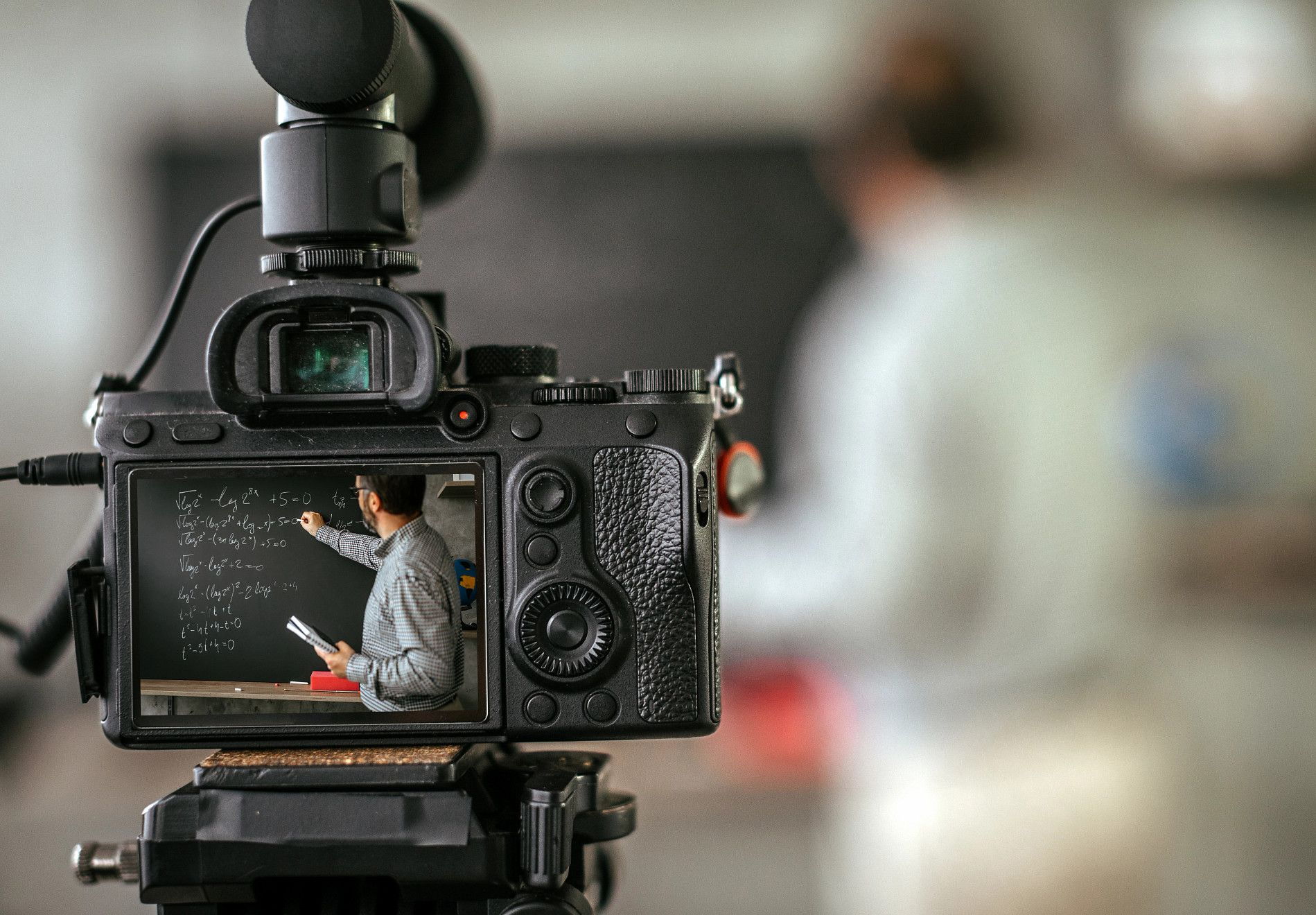 A faculty member records himself teaching on a camera