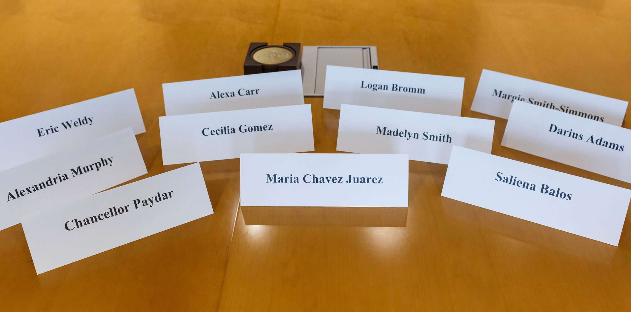 Name tags of members of the Chancellor's Student Advisory Board are organized on a table.