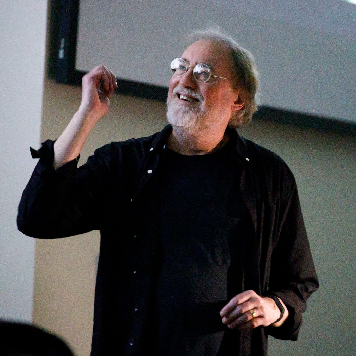 Glenn Gass reacts with a smile during a lecture