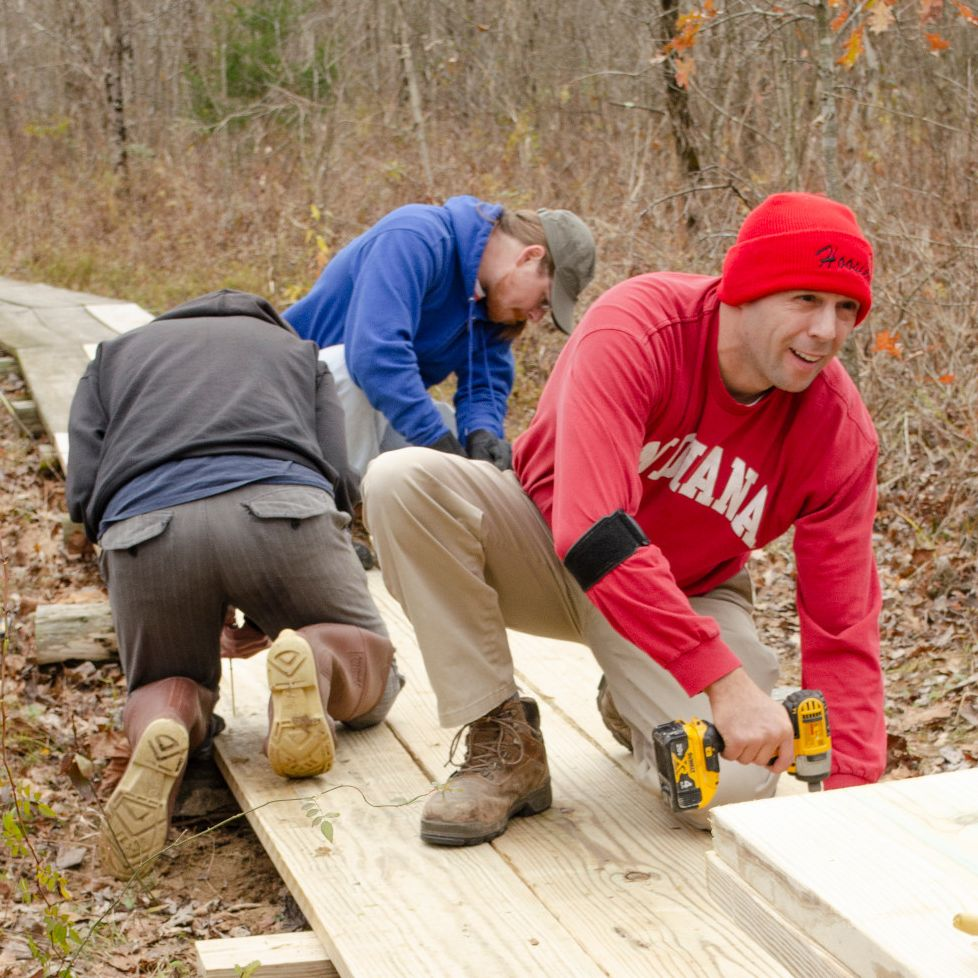 Mike Noth secures a fresh plank to the wood boardwalk at Beanblossom Bottoms.