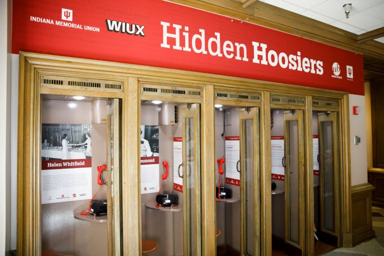 The Hidden Hoosiers phone booths line a wall at the IMU