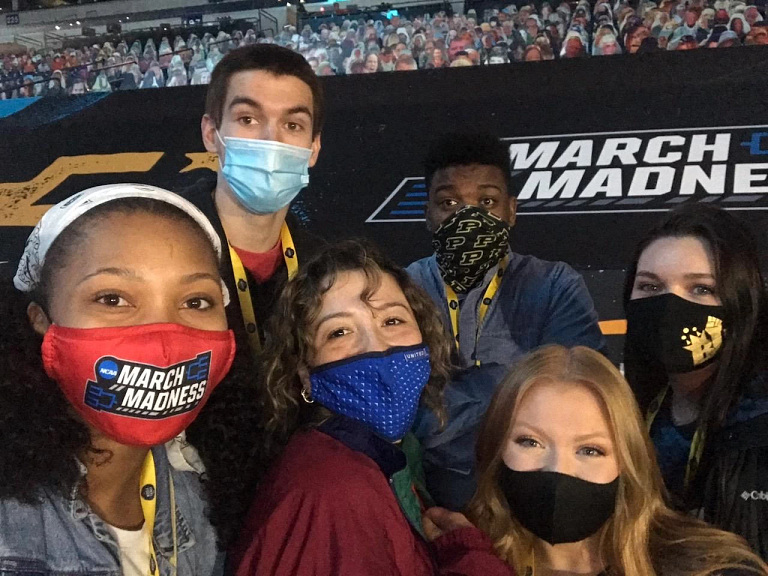 Shakana with five other people wearing masks take a selfie inside Lucas Oil Stadium