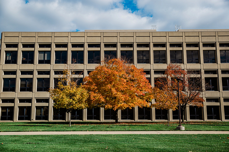 The outside of the Engineering and Technology building at IUPUI with fall trees.