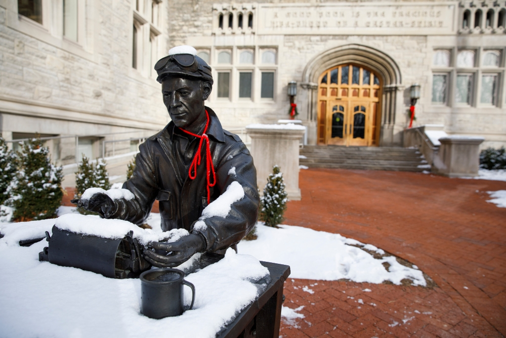 A statue of Ernie Pyle covered in snow on the IU Bloomington campus