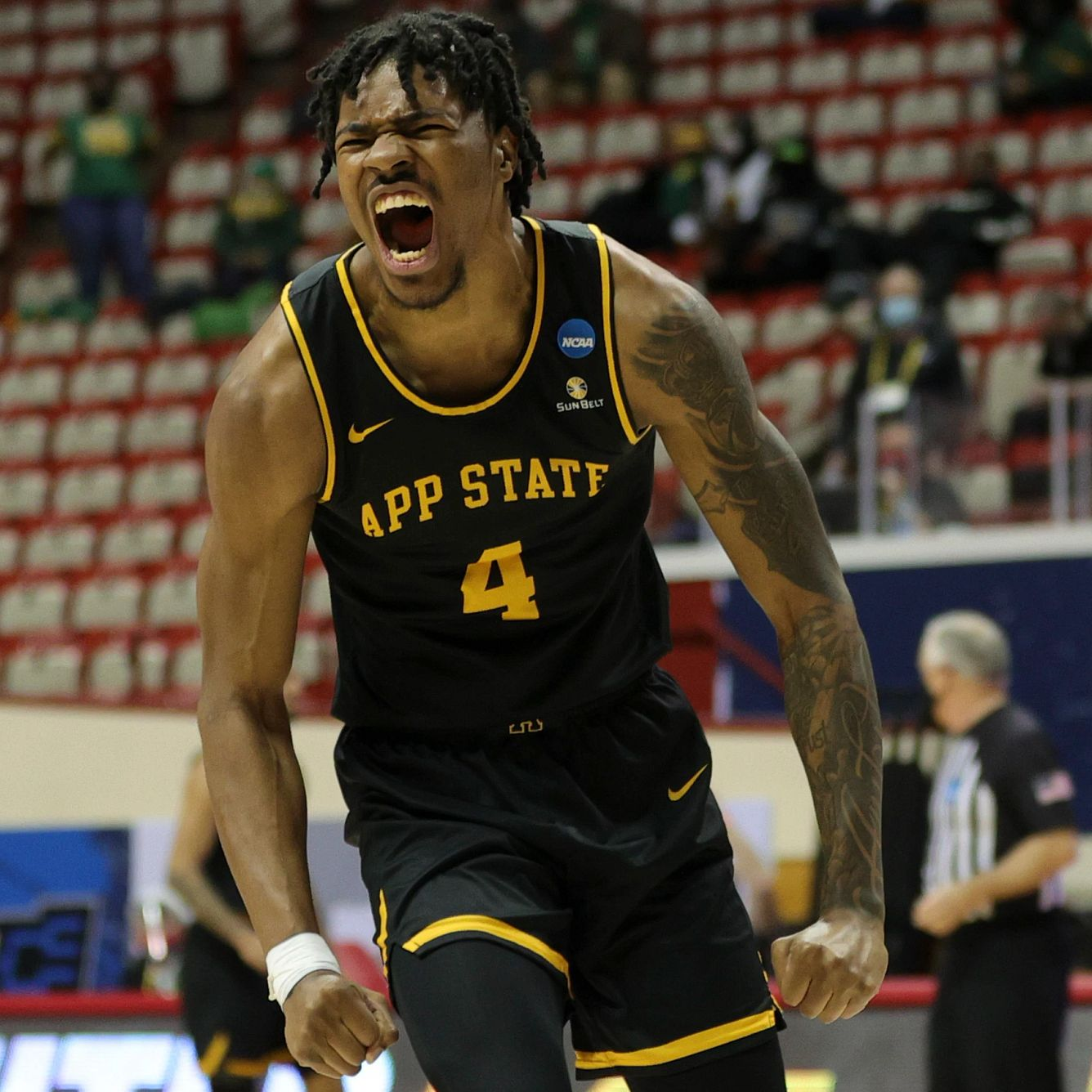 An Appalachian State players celebrates with a yell