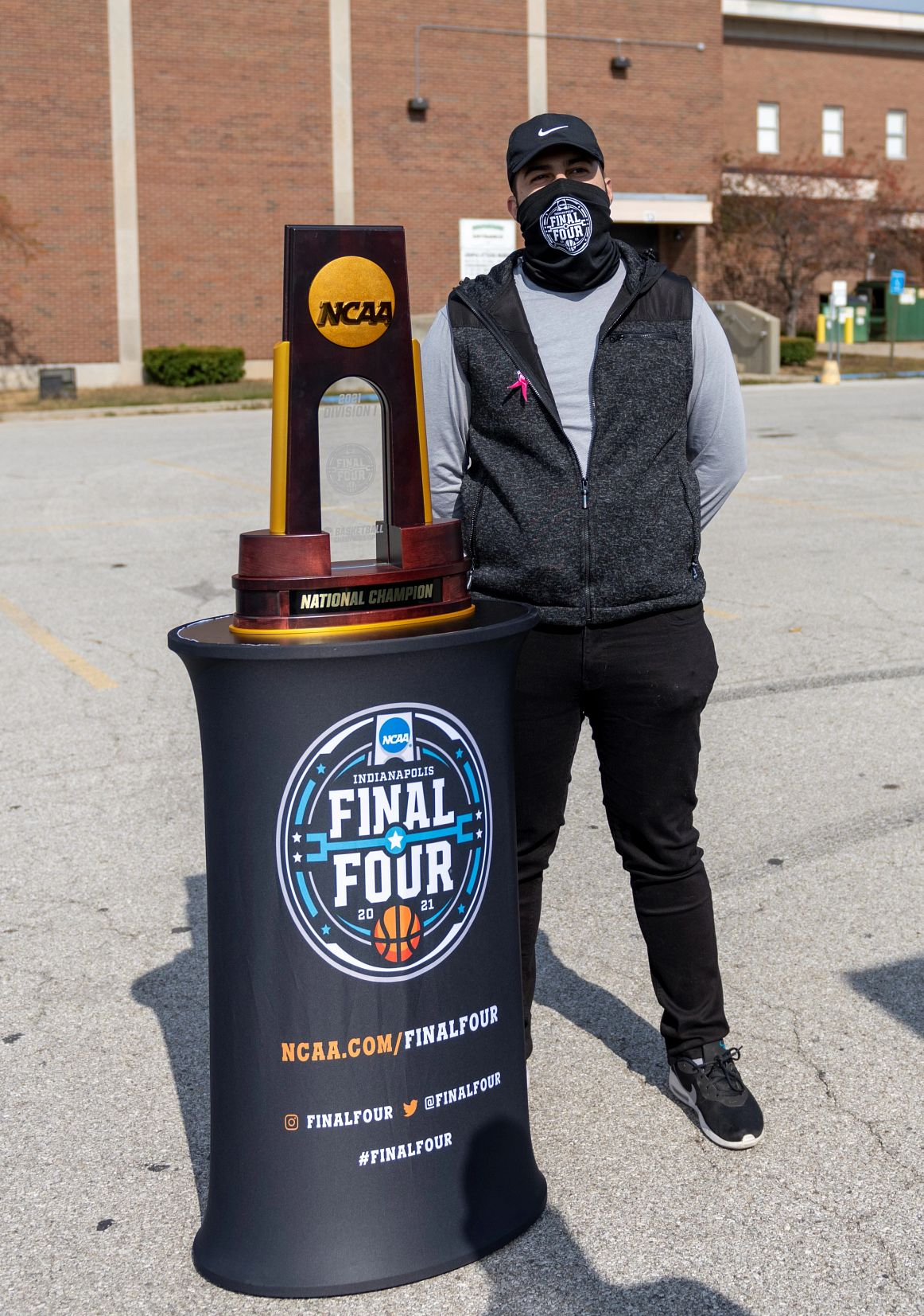 Wally stands with a NCAA championship replica trophy