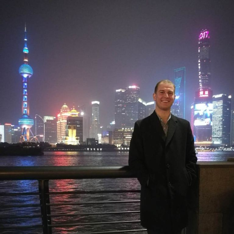 Stephen Hopkins in front of the Shanghai skyline