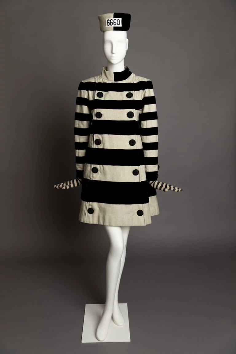 Cruella De Vil's striped mini-dress prison costume on a mannequin