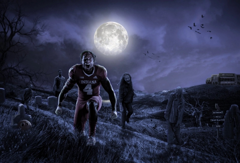 Halloween-themed art shows football player Cam Jones in a graveyard with ghouls