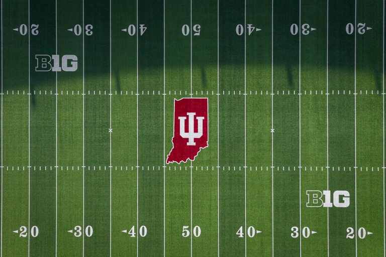 IU logo on the center of a football field seen from above