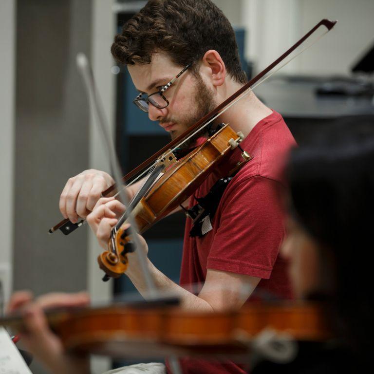 Nathan Lowry plays violin