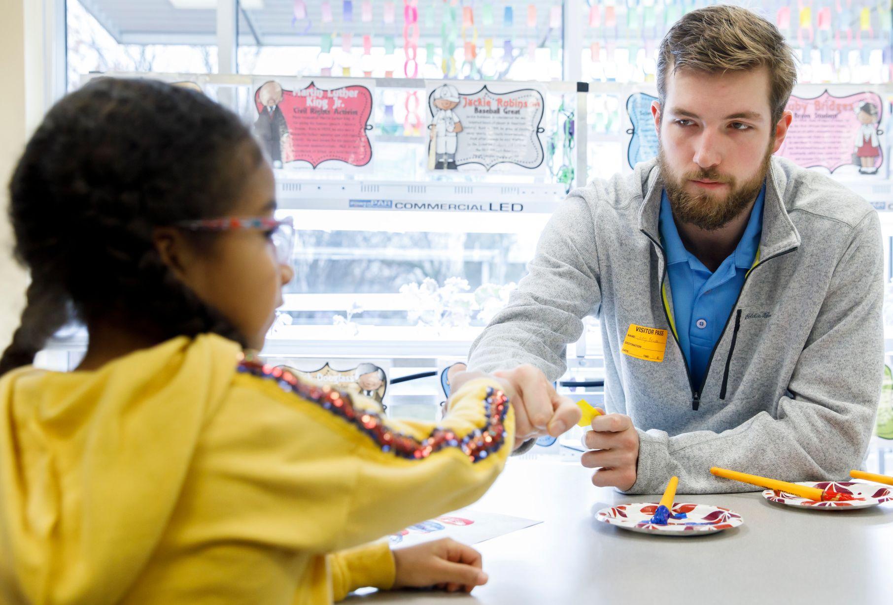 Joey Brunk fist-bumps a first-grader