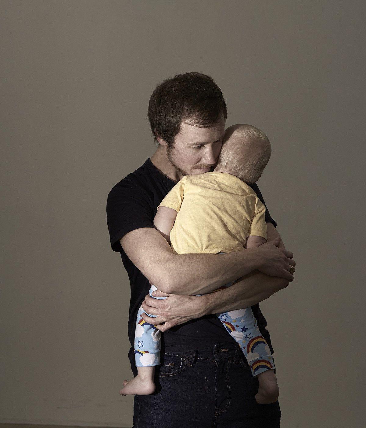 Man holds child