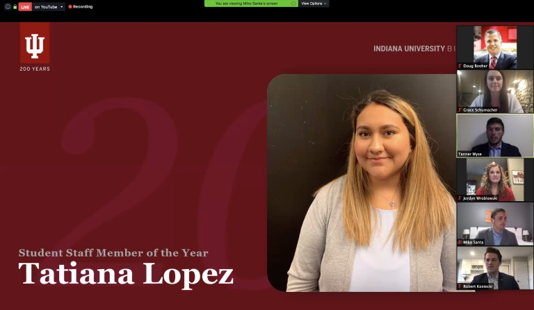 A screenshot of a virtual awards banquet showing the faces of a female student and six presenters.