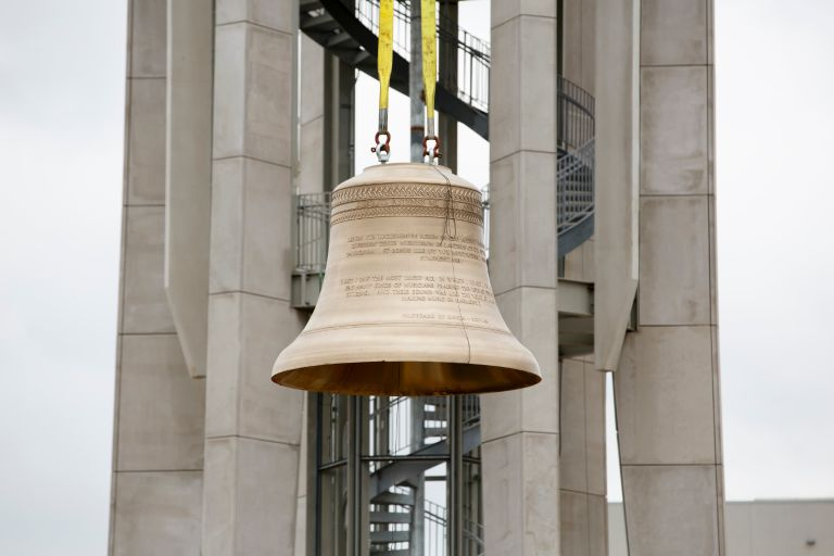 A bell is installed in the upgraded Arthur R. Metz Bicentennial Grand Carillon.
