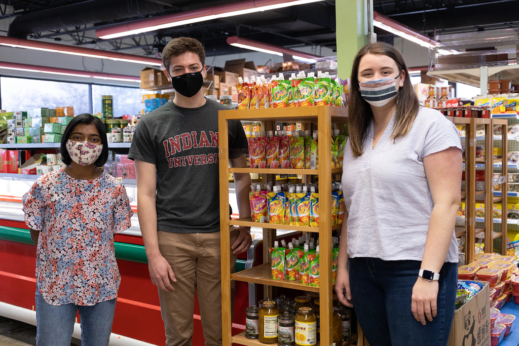 Students standing in a grocery store