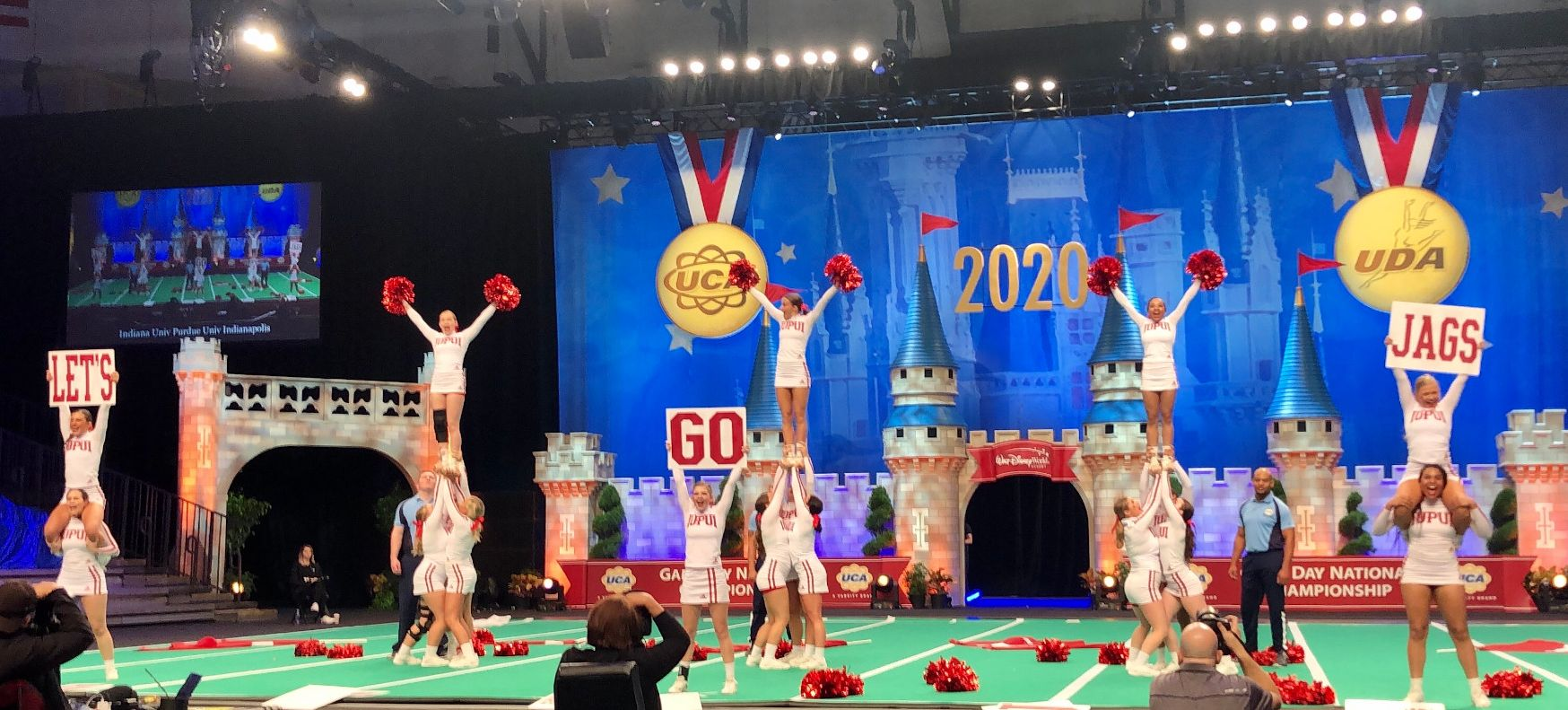 The IUPUI cheer team mid-competition at the UCA Nationals in Orlando Florida.