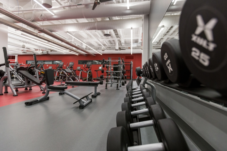 Free weights, weight machines and cardio equipment in the fitness center