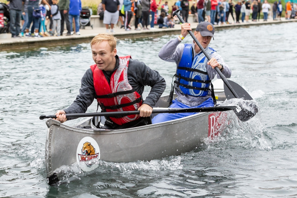 IUPUI students participate in the annual Regatta canoe race on the downtown canal.